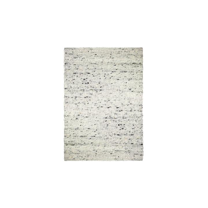 Der Filzkugelteppich Pebble von Connox Collection, 140 x 200 cm, beige meliert